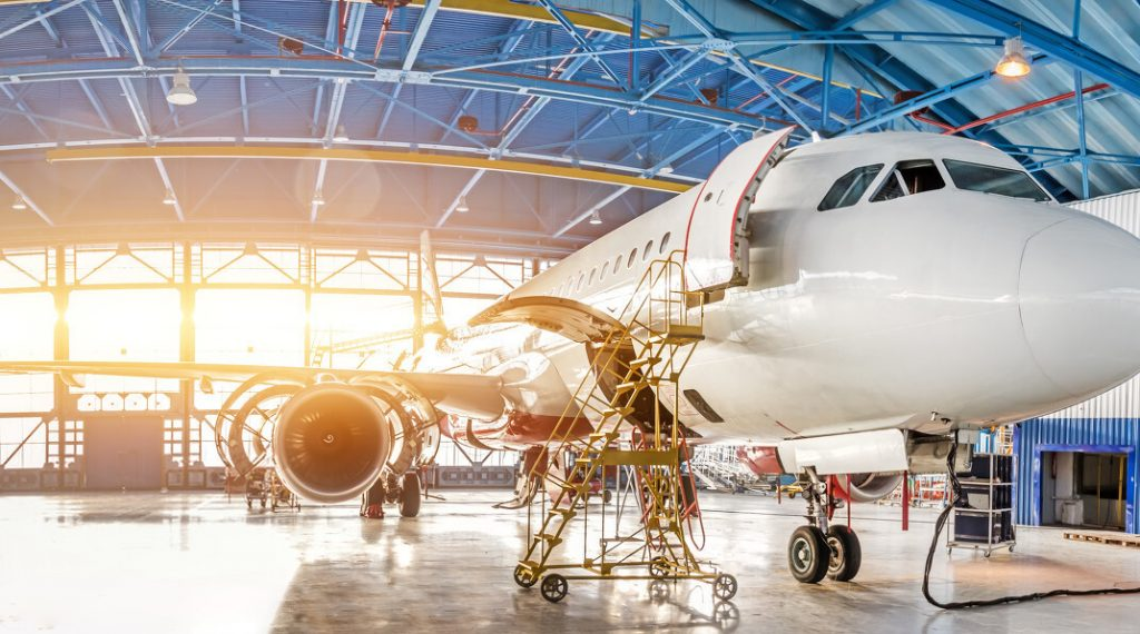 Maintenance and repair of aircraft in the aviation hangar of the airport, view of a wide panorama